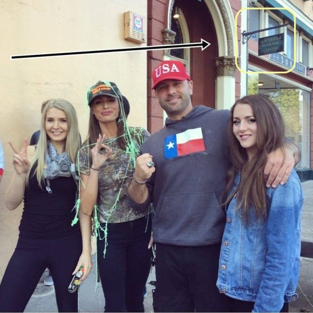 White supremacist female leaders pose with Kyle Chapman, white supremacist and nationalist icon – who has an Asian wife and a half-Asian son.
